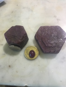 These large RUBY chunks are quite large....the smaller one with the coin is 460 crts or 92 grams. The large on 530 carats or 106 grams... and the quality is quite high.... with these larger stones they often find pockets of higher quality stone inside as they are cutting - these are a good investment spiritually and materially...
